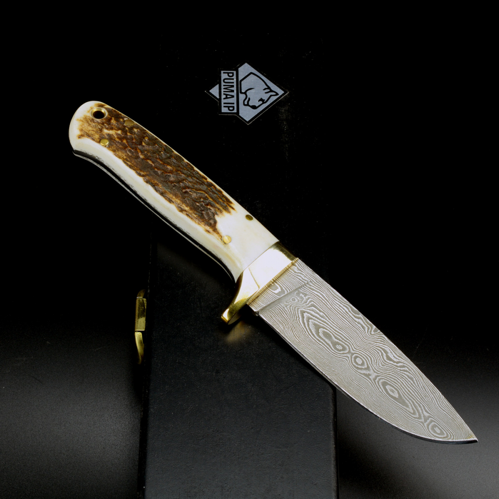 Puma IP Damascus hunting knife / collector's knife 540 layers with wooden box from 2010